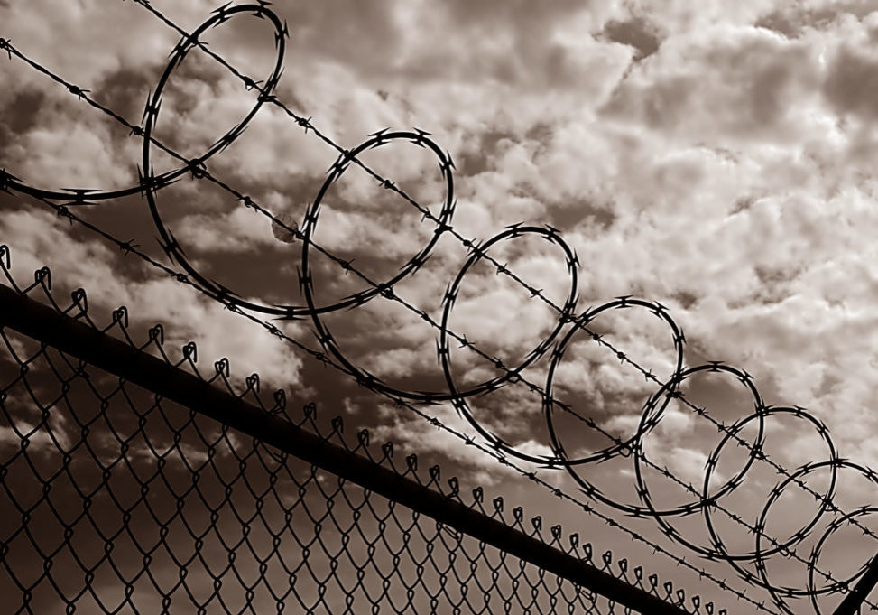 Black and white image of Razor Wire Security fence